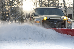 truck plowing snow | commercial snow removal